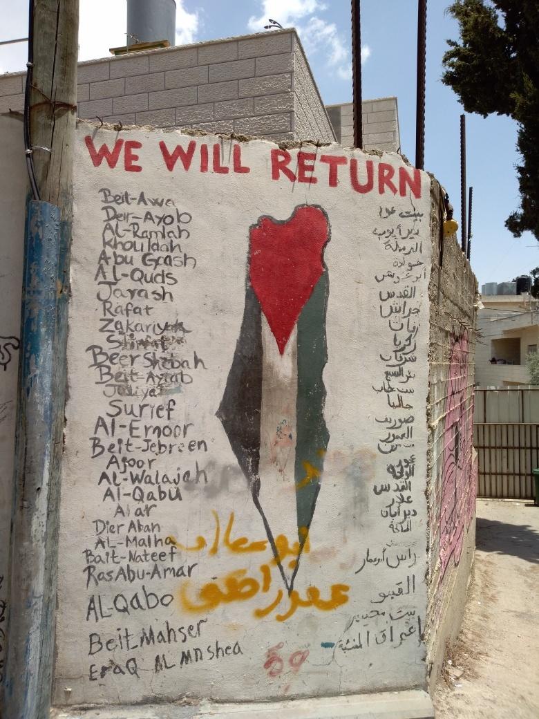 campo-profughi-Aida-murale-ritorneremo